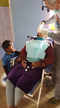 Little boy watches Mom have her tooth pulled